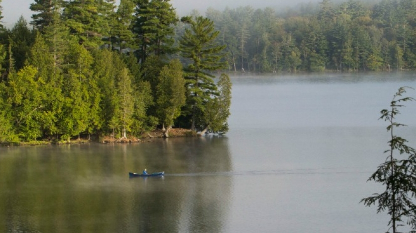 I saw this beautiful lake and then the person in the canoe came into view just as the fog was rolling out.