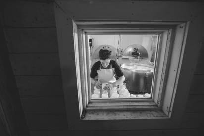 This was shot from inside the barn looking through to Margot flipping cheese in her creamery.